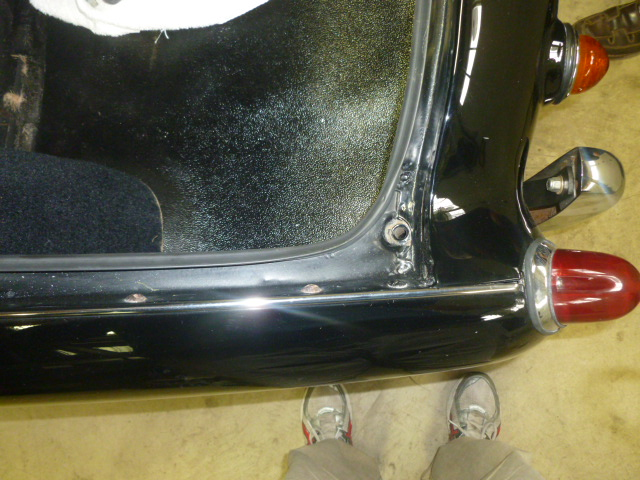 A view of the drain hole location from the top side.  Also, a view of my shoes.
